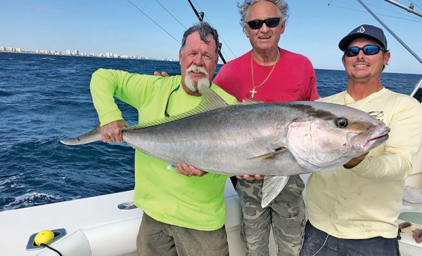 Rod, Tim and John with a big amberjack brought up off a wreck.