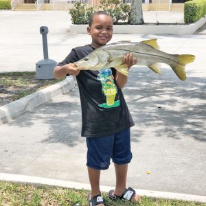 Seven-year-old Sandro Toruno with a very respectable freshwater snook.