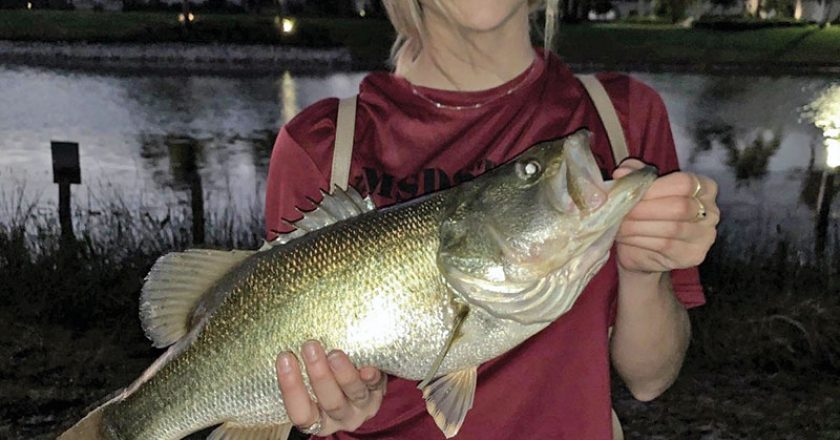 Haley Parrish with her very first largemouth bass.