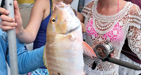 These gals caught a nice mutton snapper aboard the Catch My Drift.