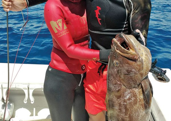 Wayne and Yen with a personal best 31 inch black grouper.