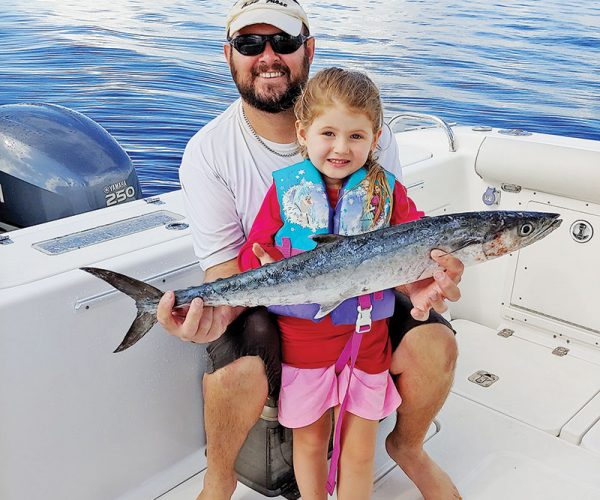 Four year old Caylee Dyer caught her first kingfish with a little help from her dad.