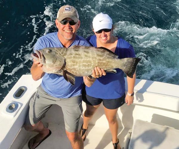 This couple scored a nice grouper aboard the Big Game.