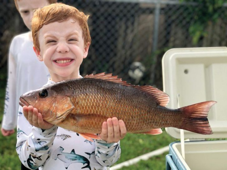 This mangrove snapper put a big smile on 5 year old Shane Prieto's face.