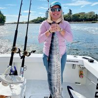 Jessica Montanaro caught this wahoo, her first fish ever, with Father and Son Sportfishing.