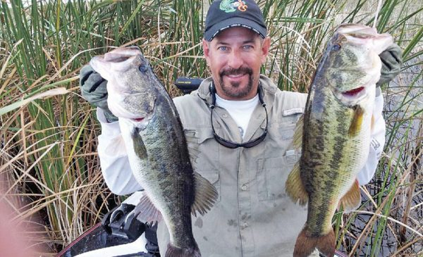 Capt. Neal with a pair of big Lake Okeechobee bass.