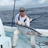 Capt. Ryan Palmer with a solid wahoo caught high speed trolling in 200 feet of Fort Lauderdale.
