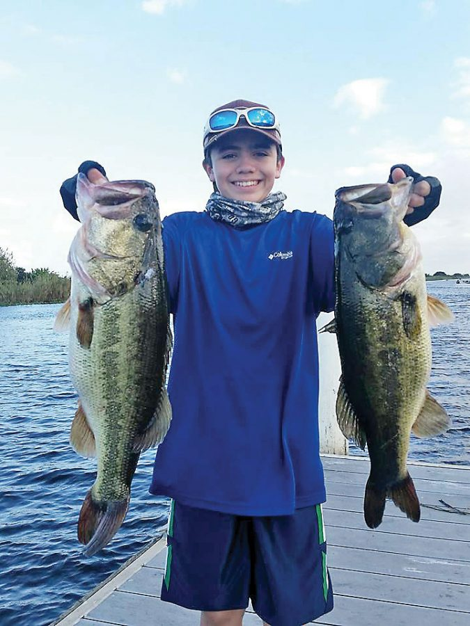 Robert Di Nino, 13, with his big bass  he caught in a Gambler tournament  on  Lake Okeechobee.