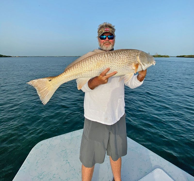 Mark with a hefty Inlet redfish.