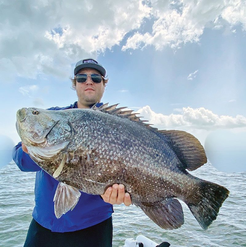 Hunter with a nice tripletail caught in the IRL.