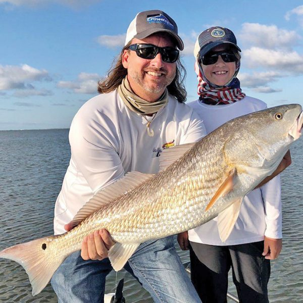 David and his son Tyler hooked this nice redfish in the Mosquito Lagoon with Capt. Travis Tanner.