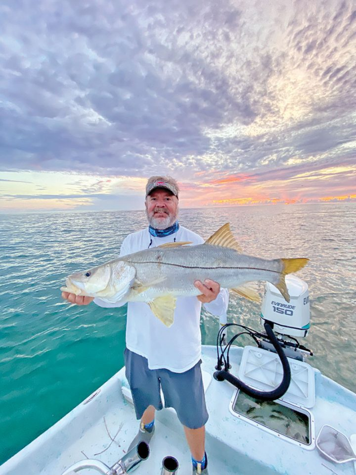 Mark with a nice beach snook in the mullet run.