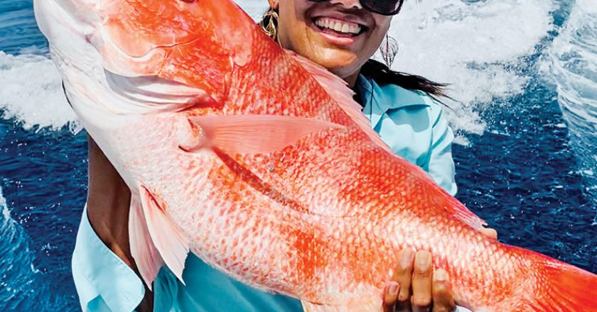 Claudia Patrizio shows off her first red snapper ever, caught recently off Cape Canaveral. Nice job!