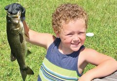 Five-year-old Zeke Thoms caught this dandy largemouth bass all by himself using his grandpa's shiners provided by Oyster Island Bait & Tackle.