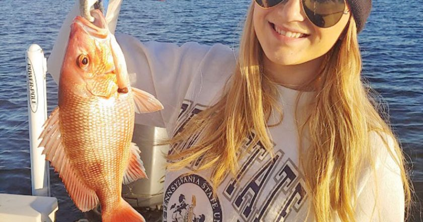 A lovely Ms. Dallas catching bay snapper on a chilly day with dad.