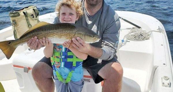 Aadyn Rauth had quite a time with this redfish on the Adrenaline boat!