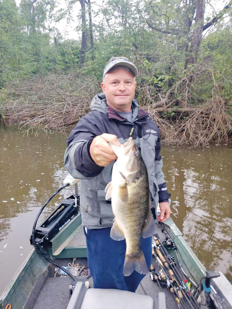 Aaron with a nice Flint River shoal bass. More about him and that river coming soon...