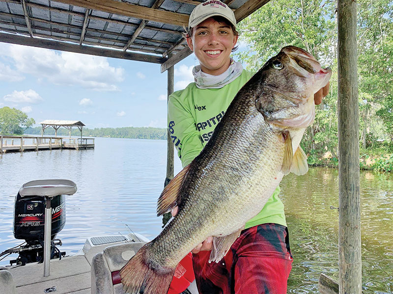 Alex Williams with a double-digit Talquin bass fishing with his dad, Colt.