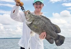 Ali Hall with a massive tripletail with Robinson Brothers Guide.