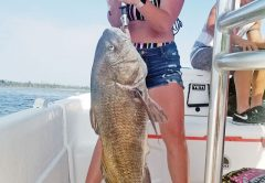 Andi Holmes had a time with this big black drum fishing with Capt. Jason.