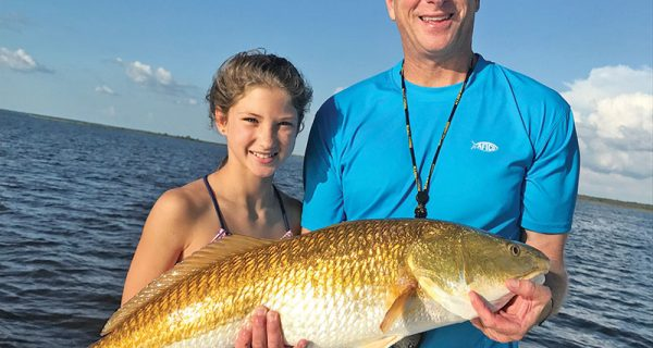 Bob Schoen and his daughter Frances haulin' reds.