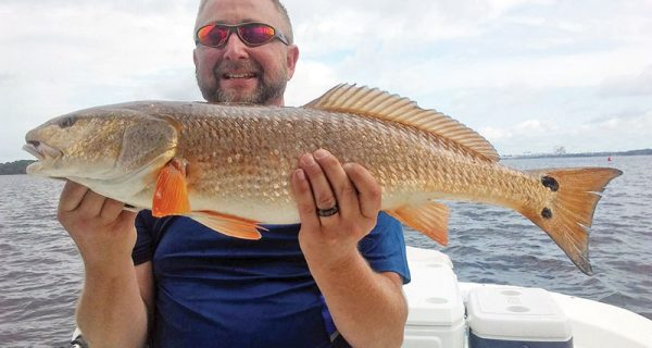 Butch Jobe with a nice redfish caught with Capt. Jason.