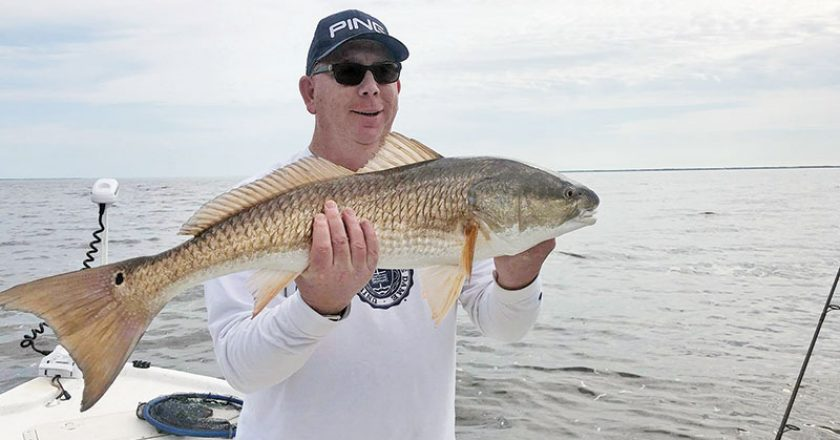 Capt. Brad Bishop putting clients on some quality Choctawhatchee Bay reds.