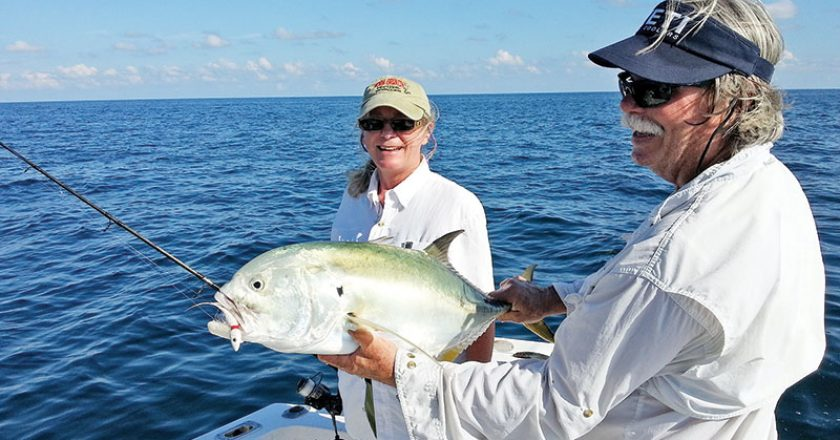 Capt. Chester holding a jack crevalle caught by Sherry Schmitt.