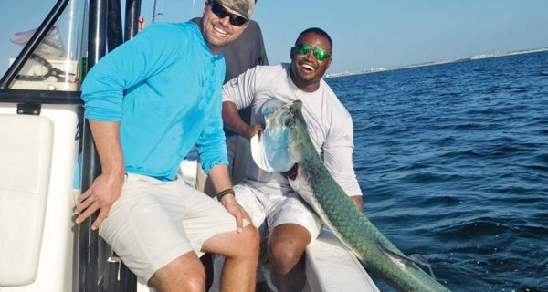 Capt. Lionel James putting clients on the tarpon.