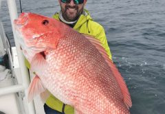 Capt. Phillip Wilds of Anchored Charters in PCB with a giant red snapper.
