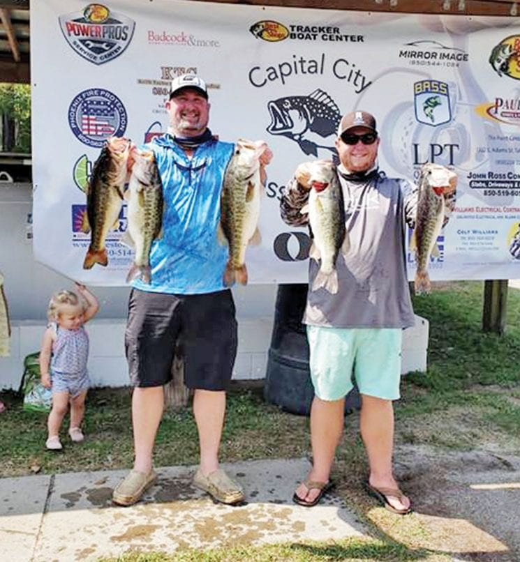 Chris Kincaid and CJ Lockamy with their winning bag of 22 pounds of Talquin bass.