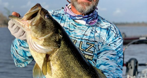 Cnote with an 8.6 pound Deerpoint bass.