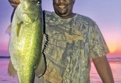 Eddie Henderson with his PB bass caught on Seminole with guide Paul Tyre.