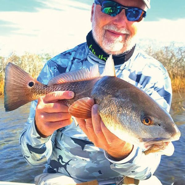 Eric Nelson, owner of Southern Cleaning Supply, convinced this red to inhale a crab pattern at 40 feet with Capt. Steve Bachman of Panama City Inshore.