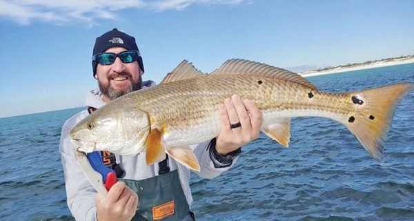 Fred Wilson with a beauty of a redfish near PCB.