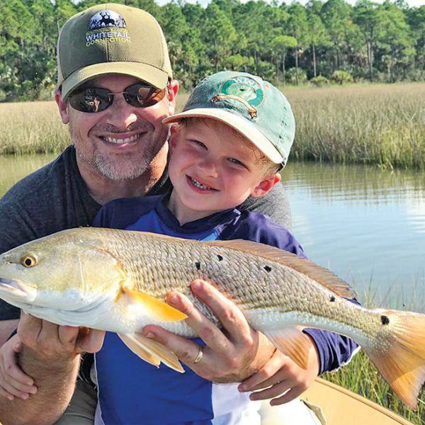Henry Hatch, 5, with his first ever redfish while fishing with his dad and Capt. Jordan Todd.