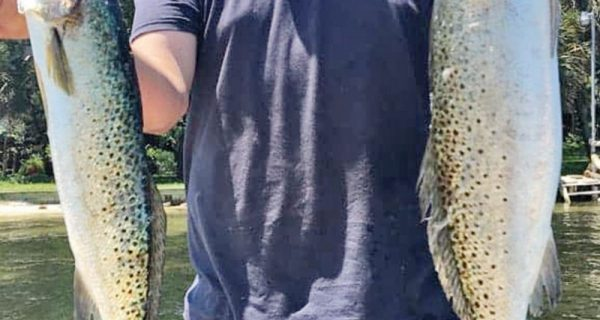 JJ Hewett with a pair of nice trout.
