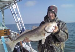John Massy with a Winter bull red fishing with Capt. Chester Reese Natural World Charters.