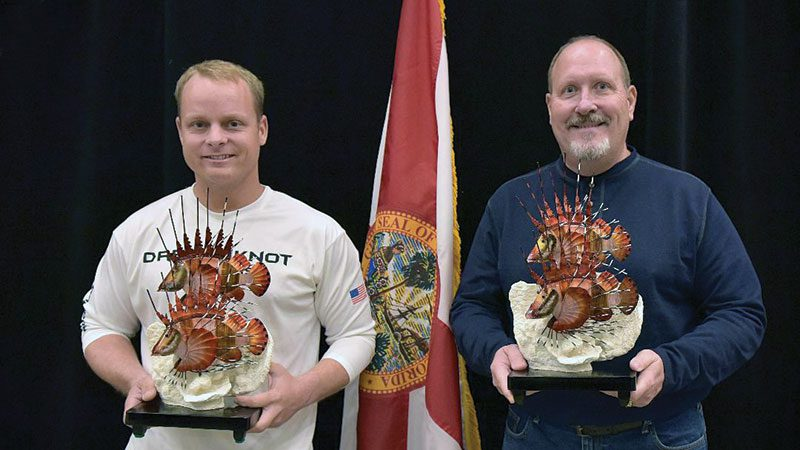 Josh Livingston and Ken Ayers pose with their trophies at a recent FWC award presentation in Panama City.
