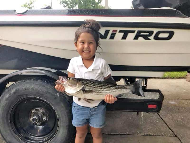Julliette Samuelson hauled this striper to the boat trolling in East River with her dad, Knowles.