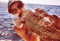 Kayla Messer smooching a gag grouper...lucky fish!