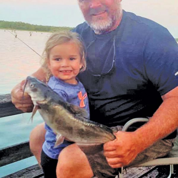 Ken Morey and his grandbaby, Autrey, with a nice cat she hauled in on Lake Seminole