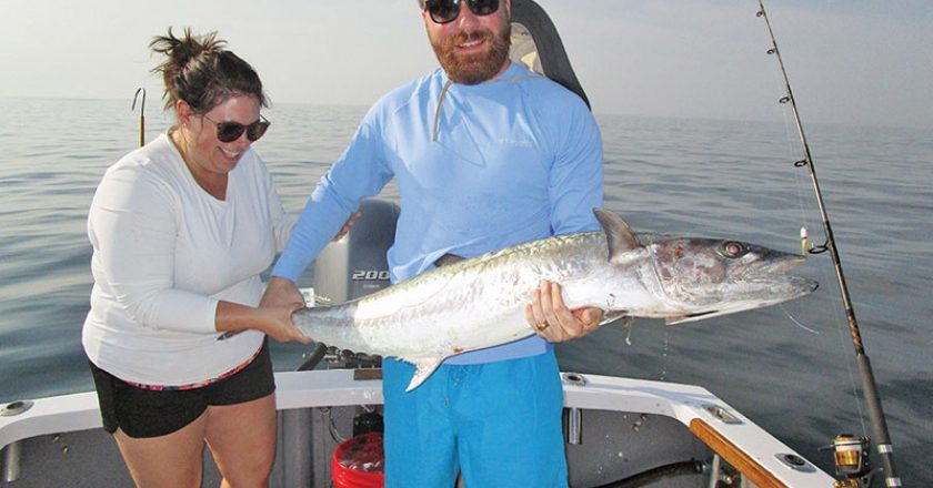 Kim and Bill Jones with a spring king aboard Natural World Charters with Capt. Chester Reese.