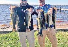 Kyle Pridgen and C-note with their 15 lb. winning bag of Deerpoint bass in the last Reel Money Team Trail event.
