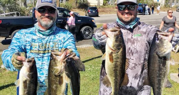 Kyle Pridgen and C-note with their winning 14 lb. bag of Deerpoint bass.