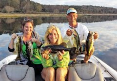 Lara Madeline, Julie Happersett & Eric Norberg holding some nice Lake Jackson bass from their day on the water with guide JR Mundinger.