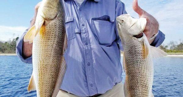 Larry Martin having some redfishing fun with Capt. Jason.