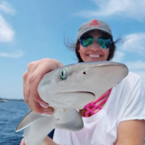 Laura picking on sharks in the bay...