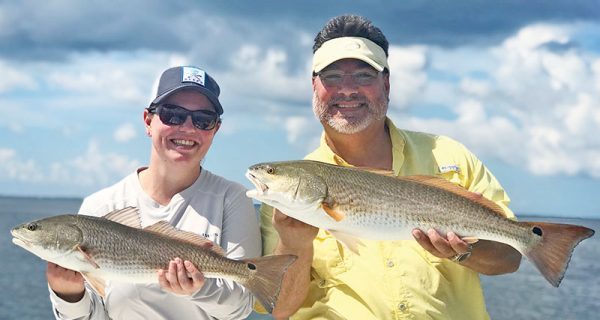 Marcus and Arden from ATL, with a nice red fish double they got with Capt Jordan Todd in St. Joe Bay.