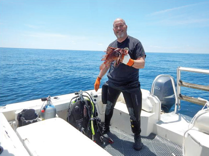 Ken with one of many of the very large lionfish he bagged.